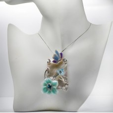 Pendant with flower and butterfly